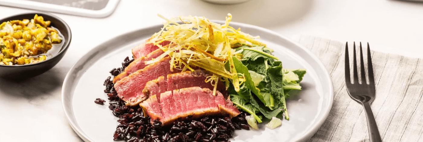Seared Tuna with Pistachio-Lemon Vinaigrette, Crispy Leeks and Midnight Rice