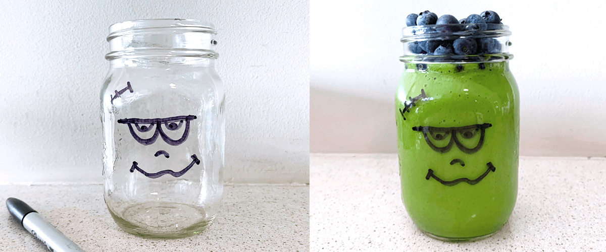 Green smoothie in a cup featuring Frankenstein's monster's face design