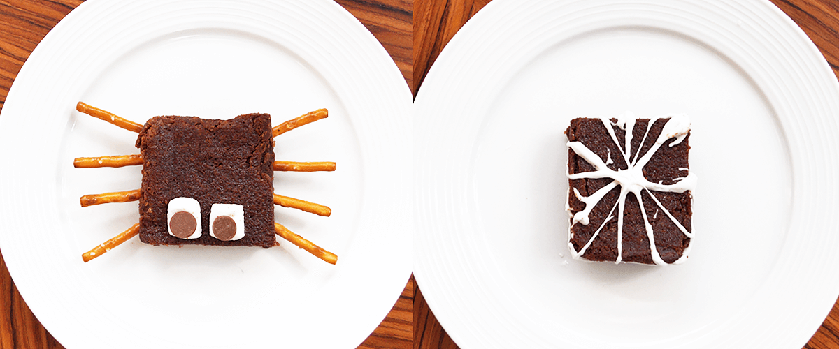 Brownie with pretzel spider legs and brownie with marshmallow webbing decoration