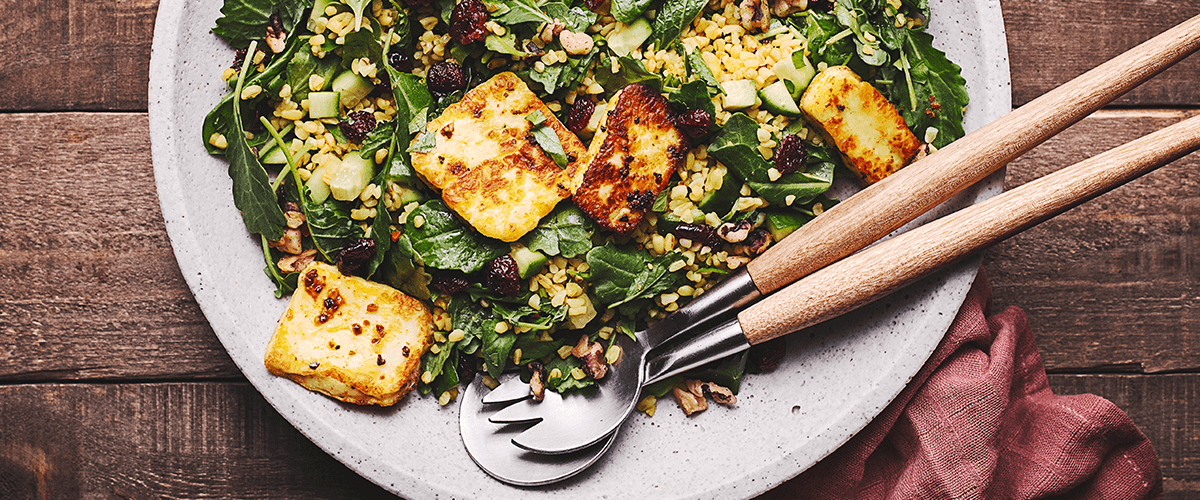 Image of a Goodfood salad featuring halloumi and baby greens