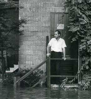 Mike Ellis at the Bucks County Playhouse during the 1955 flood, 1955. James A. Michener Art Museum. The Mike Ellis Collection. Gift of Mike Ellis.