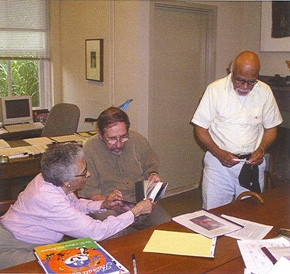 <p>Paul and Laura Keene with Bruce Katsiff in his office. James A. Michener Art Museum.</p>