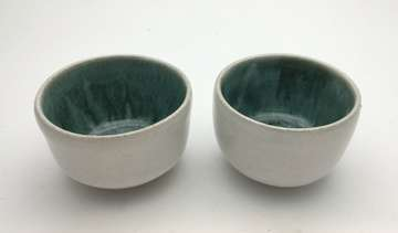 Green eye sake cups
