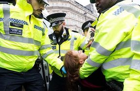 <p>Police arrested a priest in London. The accused was lying on the London airport, blocking the ground of the Airport Entrance. The action of his was in support of the mass protests by the Extinction Rebellion. The 52-year old priest, Father Martin Newell, was reported to have been praying and singing Amazing Grace. He also was heard saying Our Father during the demonstrations at the Airport. Father Newell is a priest of the Passionist Order. Reports suggest that he was arrested on 10th October.&nbsp;</p><p>Pictures released of the 52- year old priest show him lying on the ground. Another man was seen lying next to him in the protest. Father Newell travelled to London for participating in the demonstrations representing Christian Climate action. The rally held on Airport were to oppose the pollution and the harmful environmental impact that the aviation industry and the proposed expansion of Airport.&nbsp;</p>