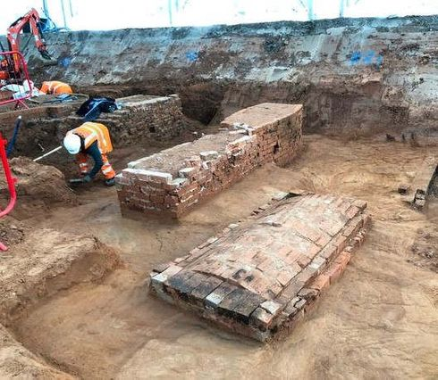 <p>Over 6500 Bodies have been dug up from a burial ground in Birmingham where an HS2 station is set to be built. A time-lapse video was released showing the 12-month phase of the work. Over 70 archaeologists from MOLA headland infrastructure were involved in the project. The cemetery was built in 1810 and acted as a burial ground for St Marlin In the bullring till it closed in 1873.&nbsp;</p><p>Archaeologists are now beginning to examine the skeletons along with the artifacts discovered in the digging. The nameplates found in the discovery has been smaller than the people buried at the site. The archaeologists will study various historical records to find the biographies of these individuals. These findings will be shared will the local community on National Trust's Heritage Open Day.</p><p>Ground Remediation will be the next on-site work now. The lead archaeologist Claire Cogar told the press how these excavations have helped understand the lives of people in the 19th century Birmingham. After careful excavation, the archaeologists have found the various diseases that prevailed such as scurvy as well as few new burial rituals and traditions.</p><p>Head of program directors Mike Lyons states that this is a significant milestone for Birmingham, which is at the heart of the HS2 network. He further added that this excavation would tell the life of those skilled workers who made Birmingham a leader in the Industrial revolution.&nbsp;</p><p>These bodies will be reburied in some other burial-site in Birmingham.&nbsp;</p>