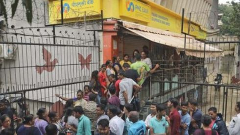 <p>The PMC Bank crisis has united shopkeeper in Mulund, They have called for a bandh on 15th of October. The PMC bank crisis has affected thousands of depositors, they cannot withdraw funds and will not gain any interest on their money.</p><p>The shopkeepers to register their protest have announced a complete band and have urged the citizens to participate in this protest.&nbsp;The leader of shopkeeper union as said that depositors have suffered a lot because of this crisis.</p><p>Nirmala who is the finance minister has announced to make policies which will help secure depositors money. She also promised to depositors to not worry about the crisis and have offered full support.</p><p>The accused HDIL director and his son have arrested also the managing director of PMC, Joy Thomas is behind the bars.</p>