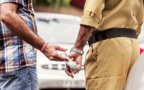 <p>The Anti-corruption Bureau (ACB) arrested a traffic police brigade which includes traffic jawan and traffic rakshak dal. They were arrested near Nirma University on SG Highway for taking a bribe of Rs 200.</p><p>The ACB received a complaint that stated that some of the traffic police are illegally asking for money without giving receipts. The ACB laid a trap around the city to arrest the culprits.</p><p>The ACB placed a dummy person who was asked for Rs 200 bribe, they were caught red-handed by the officers. The ACB officials place such traps often to catch the police who ask for a bribe.</p><p>The ACB as a number 1064 on which any person can call and complain about the bribe and other issues. The two accused will be present in the court on Tuesday for further inquiry.</p>