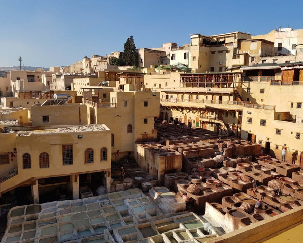 """<p><strong style=""""color: rgb(161, 0, 0);"""">Fez is a huge ancient city-market of artisans, which continues to live its own life. In addition to tourist facilities, people in different areas really live here, they have their own schools, hammams, bakeries and mosques. The city really consists of thousands of streets, streets and alleys, it seems to me that poking around here yourself, without a guide, is dangerous in the sense that you can calmly get lost and spend hours wandering around these mazes. </strong></p><p><br></p><p><strong style=""""color: rgb(0, 71, 178);"""">Here, a little more intrusive sellers than in other Moroccan medins and markets. This is especially true of purse merchants who literally divided the old city into separate zones and pursue groups in their area, keeping up and trying to suck in their goods. Although Fez is considered the most criminal city in Morocco, we did not feel this, on the contrary, one tourist from our group lagged behind us and the local people immediately told him how to find us. We did not go to a souvenir shop, a carpet shop (there was the most intrusive seller), then to a tannery - it must be visited. </strong></p><p><strong style=""""color: rgb(161, 0, 0);""""><span class=""""ql-cursor""""></span></strong></p><p><strong style=""""color: rgb(0, 138, 0);"""">This is a production where leather is made according to medieval technologies in a huge courtyard, where there is an unbearable smell and in terrible working conditions tanners process leather. There is a terrible stench and they all give out bunches of fragrant grass so that you can smell it and drown the stench. Alas, working in terrible conditions to make leather, then absolutely artisanal and low-grade products are sewn from this leather, which are sold here, but did not cause us any interest. Go to the medina of Fez is a must.</strong></p>"""