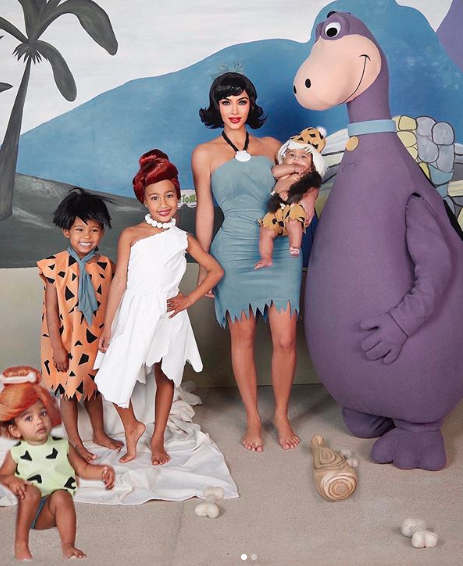 """<p>(CNN) The Kardashians are known for their fun Halloween costumes. They were angels, playboy bunnies, and even forest fairies.</p><p>But for the Kardashian-West family portrait of this Halloween, things were a bit more frightening. Well, at least for one-year-old Chicago.</p><p>The family of six were dressed like the Flintstones, and Kanye was none other than Dino the Dinosaur.</p><p>""""This family photo was such a struggle because Chicago was so afraid of Dino!"""" Kardashian said on Twitter and Instagram.</p><p>""""We tried to explain to tell her that it was just daddy, but she didn't get the idea yet! But shout out to the photographer for filming her and having our Flinstone family dream come true!""""</p><p>Although the reality star seemed grateful to the photo editing, not everyone thought the photographer was doing a good job of making the family's """"dreams come true."""" Baby Chicago seemed a little out of place. A part of her foot was missing to be precise.</p><p>""""You have to hire a new editor said one person on Twitter.</p>"""