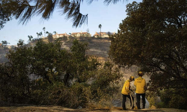 """<p>Millions of them without strength. A hundred thousand were ordered to evacuate. Most of the day, the major highway through Los Angeles opened as the hills above burned.</p><p>The California wildfire season is disrupting daily life and highlighting the weaknesses of official responses to climate disasters, even in a rich and technologically advanced state.</p><p>At least three people were confirmed dead in the wildfires on the outskirts of Los Angeles on Friday.</p><p>In the Saddleridge fire in the north of the city, officials said 13 buildings had been destroyed and 18 more had been damaged. To the east of the city, 74 buildings were destroyed and 16 damaged by a fire that swept through a mobile home park in Calimesa. There were two people who died, officials said.</p><p>The fires in Los Angeles raged as electricity was restored to most of the almost 2 million people in the northern part of the state who were lost by Pacific Gas &amp; Electric on Wednesday, seeking to prevent a repetition of the past two years when its equipment ignited devastating, damaging fires in windy weather.</p><p>The blackouts that affected areas of the San Francisco Bay Area put at risk medically vulnerable people, highlighted local officials ' lack of preparedness to support at-risk communities, and led Governor Gavin Newsom to condemn PG&amp;E for """"greed"""" and """"poor governance.""""</p><p>The area has been on high alert as strong Santa Ana winds carry dry desert air to a desiccated landscape that needs only a spark to explode. Fire officials have warned that they expect more severe and destructive fires due, in part, to climate change.</p><p>No stranger to the fires that struck his Los Angeles corner, 73-year-old Edwin Bernard, but they never came this strong or near his home before.</p><p>He and his wife were among about 100,000 people forced out of their homes because of the wind-driven blaze that broke out in the San Fernando Valley on Thursday night. It extended west through the tinder-"""