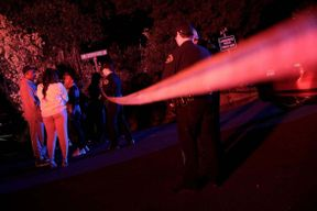 """<p>Roses, votive candles and homemade posters hang over the mailbox at 114 Lucille Way in Orinda on Saturday, the scene of a Halloween attack that left five people dead.</p><p>The violence that erupted during an unapproved but commonly-promoted """"Mansion Party"""" blew the residents of the quiet East Bay City and began calling for a temporary moratorium on Airbnb rentals.</p><p>Police were still looking for suspects examining bullet casings and investigating two guns found at the crime scene as people were struggling to move on. Violence is rare in this wealthy hilly area of Contra Costa County, known for its soccer fields, hilly avenues and the Shakespeare Theatre in California.</p><p><br></p>"""