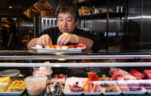 """<p><span style=""""color: rgb(56, 56, 56);"""">Famous Ryuichi Nakano sushi chef runs restaurants across in Seattle for 16 years, but he left tangle town last fall.</span></p><p><span style=""""color: rgb(56, 56, 56);"""">Now he is coming back with a restaurant with 32- seating capacity-&nbsp;Sankai. It will be located in downtown Edmond. The price of his omakase and&nbsp;nigiri are 10 slices for $40 and 14 slices for $50 also&nbsp;sashimi is available for $50.</span></p><p><span style=""""color: rgb(56, 56, 56);"""">His regular customers were very disappointed to know that they will not be able to see his sushi bar in Seattle again. According to&nbsp;Ryuichi Nakano, I never thought that I would sell my restaurant last fall but one-morning real estate agent approached him and offer a good amount of money to sell his restaurant and I couldn't say no to his offer. His offer turned out to be enough for me to take some break and open a new and big restaurant.</span></p>"""