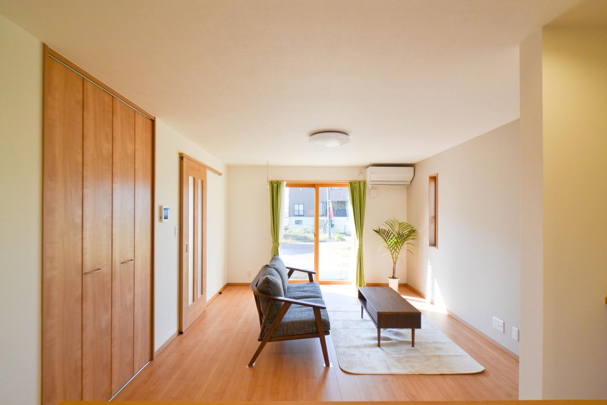 コモホームハセガワ株式会社「明るい家族の暖かい家」の実例写真