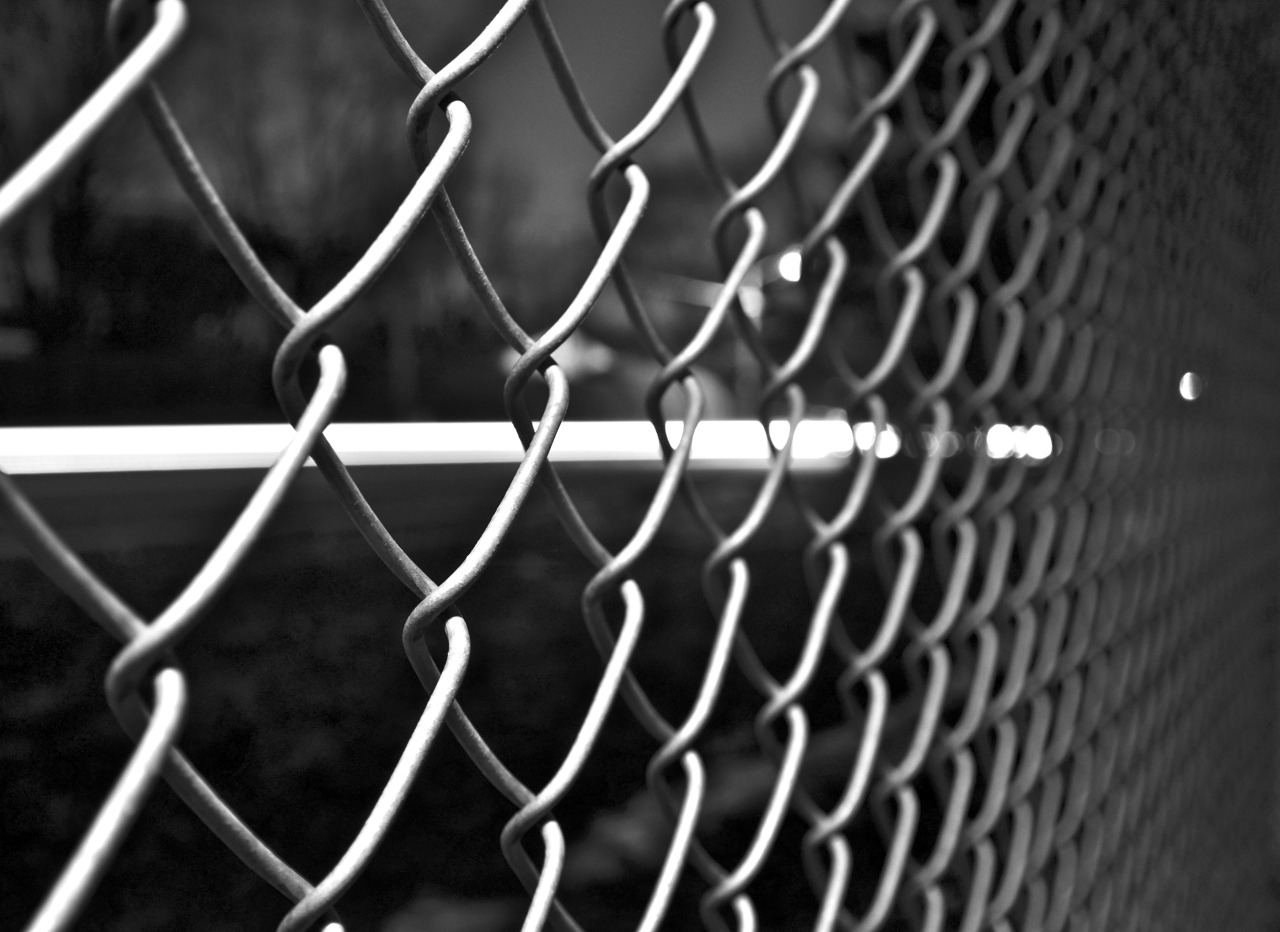 A closeup of a grey chain link fence.