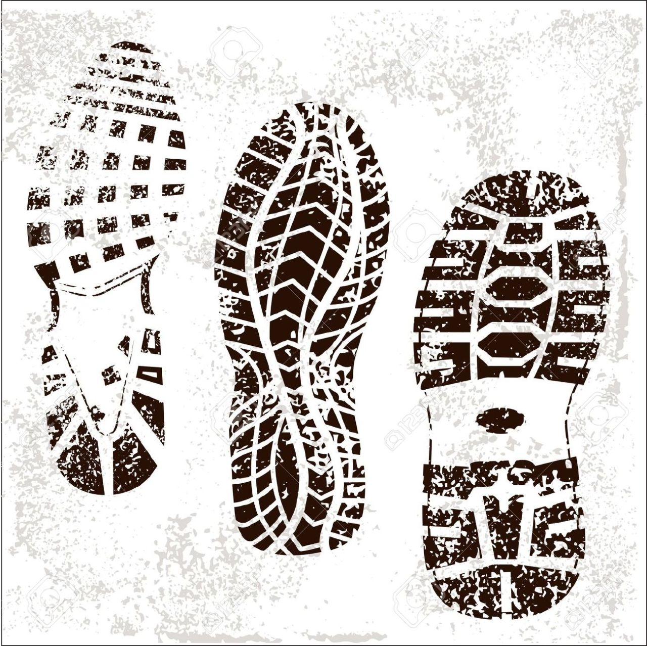 A picture of black shoeprints on a white surface.