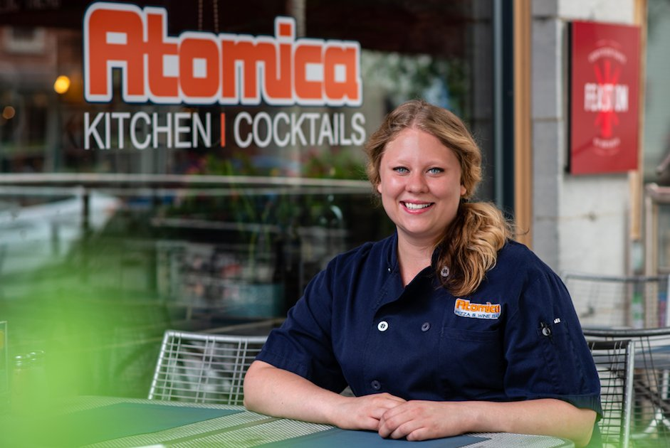Photo of Chef Cass Mercier on the sidewalk patio at Atomica Kitchen in Kingston, Ontario