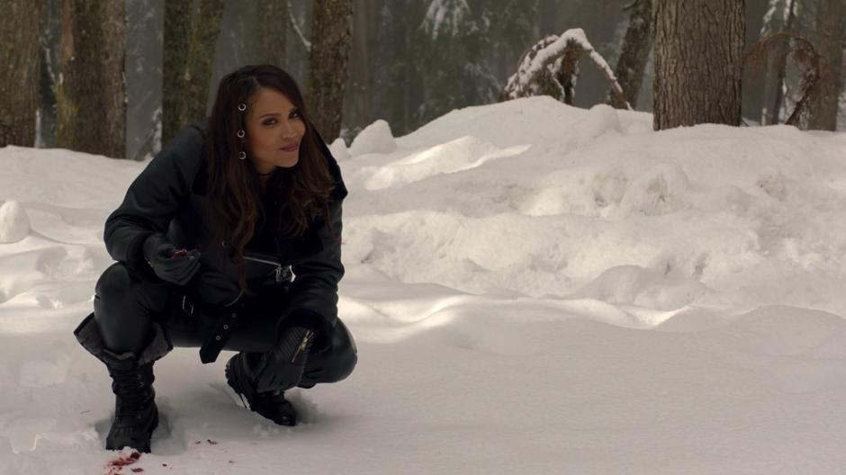 Maze looks up and smiles after finding a trail of Ben Rivers's blood in the snow.