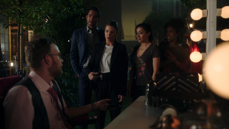 Bobby Lowe tells off the PA while Lucifer, Chloe, and Ella come up to ask him questions.
