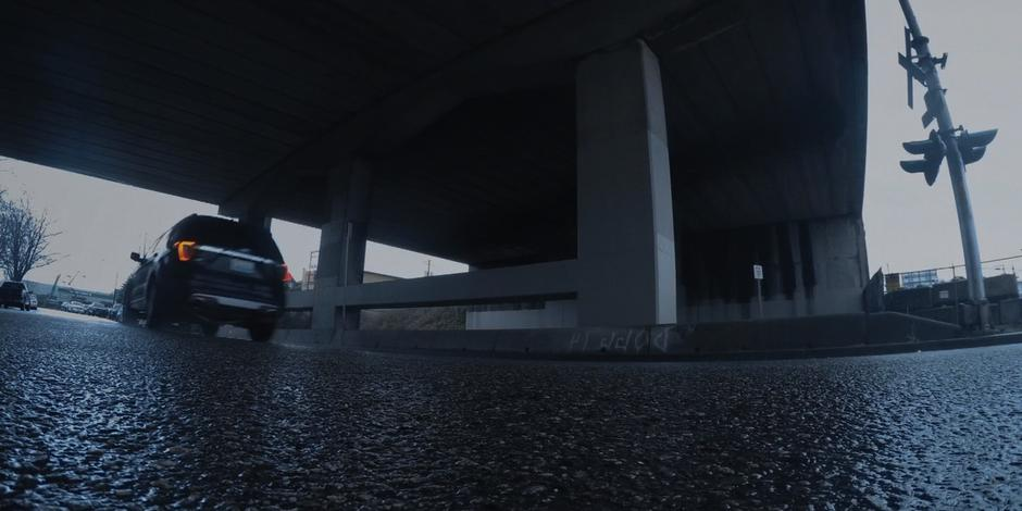 Grant's SUV drives through the underpass.