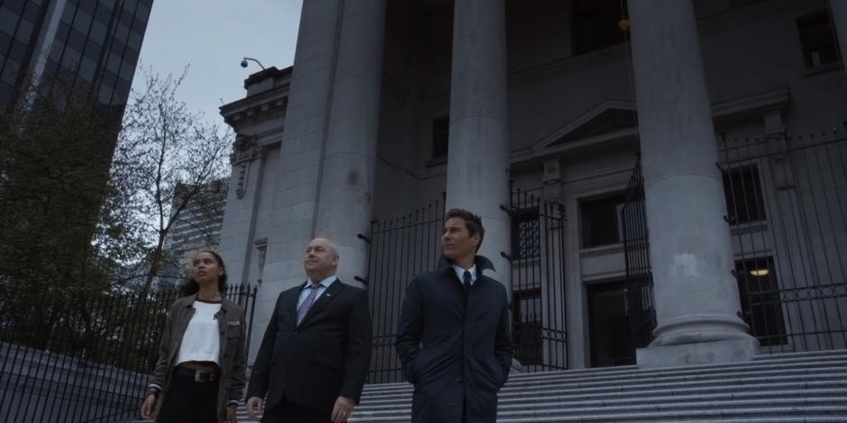 Carly, Ted Bishop, and Grant look around the steps where the speech will take place in preparation for the assassination.
