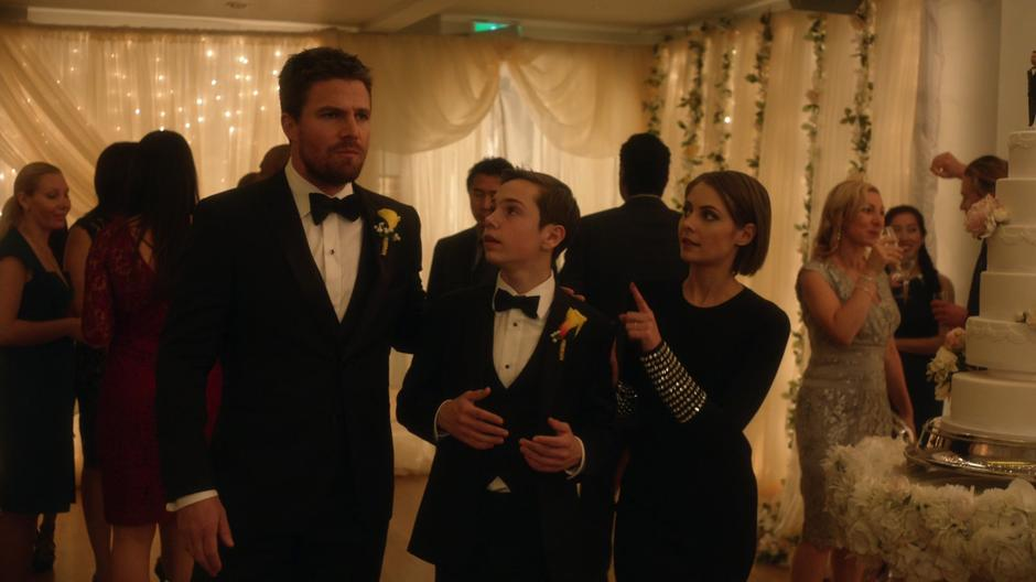 Oliver, William, and Thea chat during the reception.