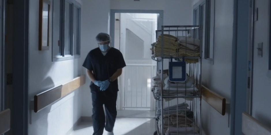 Rick walks down the hallway from the stairs to Kat's room.