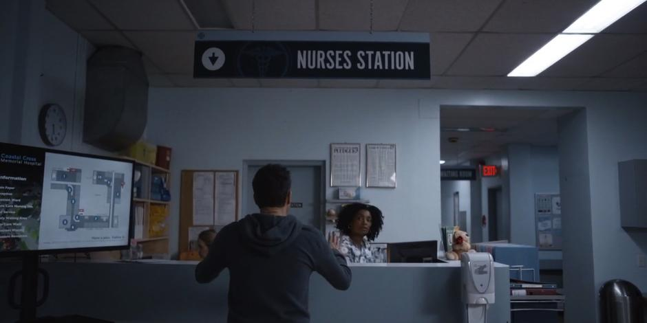 Grant approaches the nurse looking for an update.