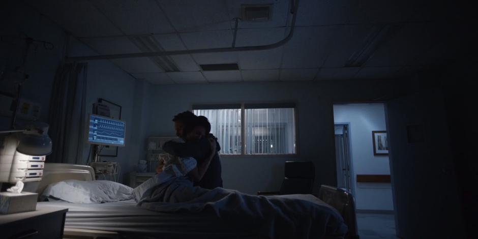 Grant hugs Kat in the hospital room after getting the bad news.