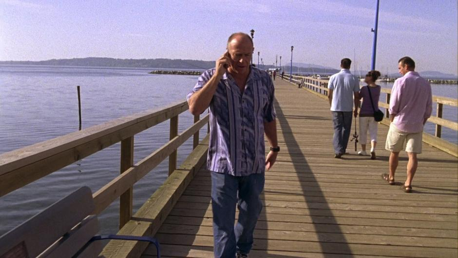 Henry calls Shawn on the phone from the pier.