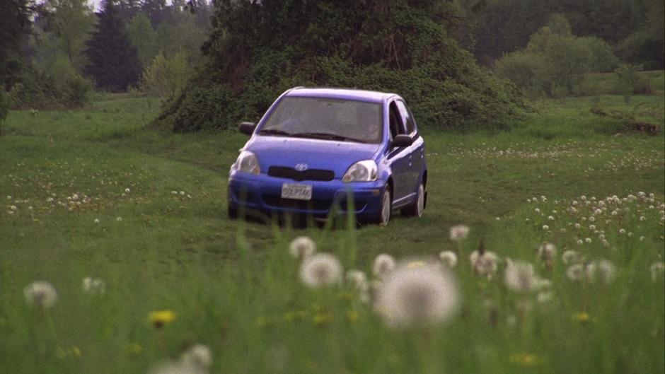 Gus drives the Blueberry across a field with Shawn.