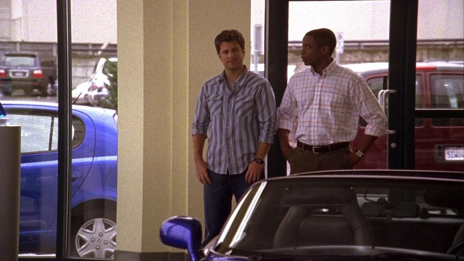 Shawn and Gus walk into the dealership.