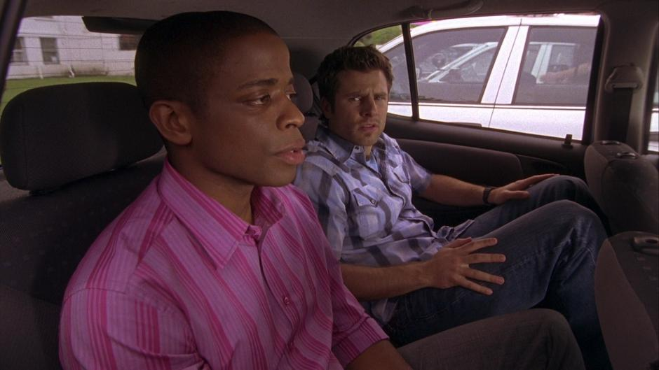 Gus and Shawn sit in the back of the Blueberry.