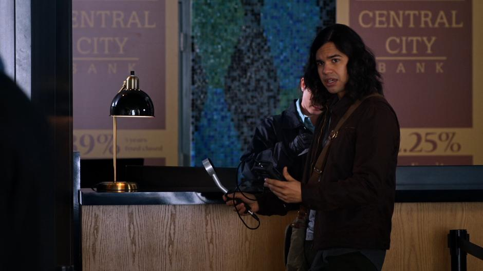 Cisco turns to Joe and tells him about the radiation.