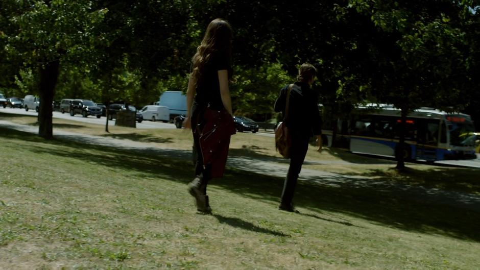 Julia and Quentin walk away from the group.