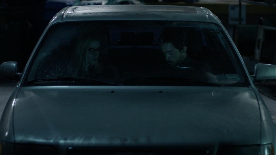 Alice talks to the vampire in the front of his car.
