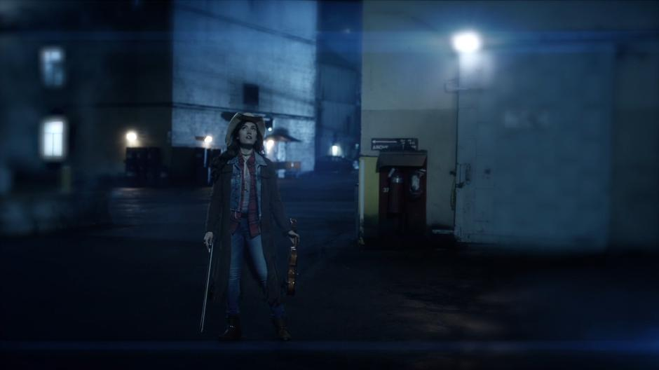 In Cisco's vibe vision, Izzy Bowin stands in the middle of the buildings calling out DeVoe.