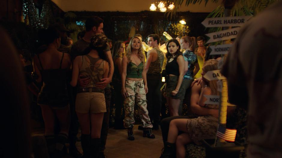 Lucy stops her conversation with Maggie in the middle of the party to remind everyone about the anti-alcohol policy.