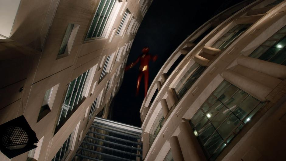 Barry flies off into the air after being hit by Null's power.