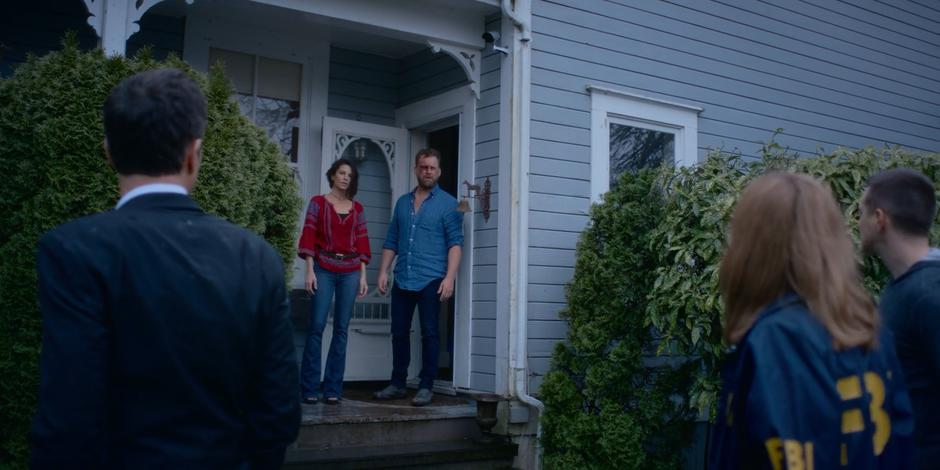 Grant, Marcy, and Trevor turn to see Kat and David standing outside the back door.