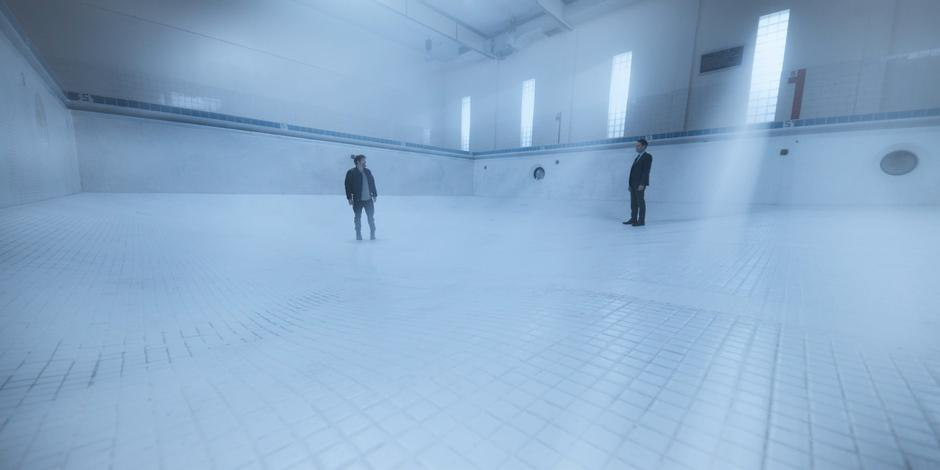 Hall turns around and sees Grant standing behind him in the ethereal pool.