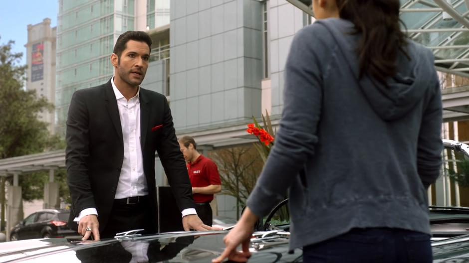 Lucifer tells Ella about Louie Pagliani while they stand beside his car.