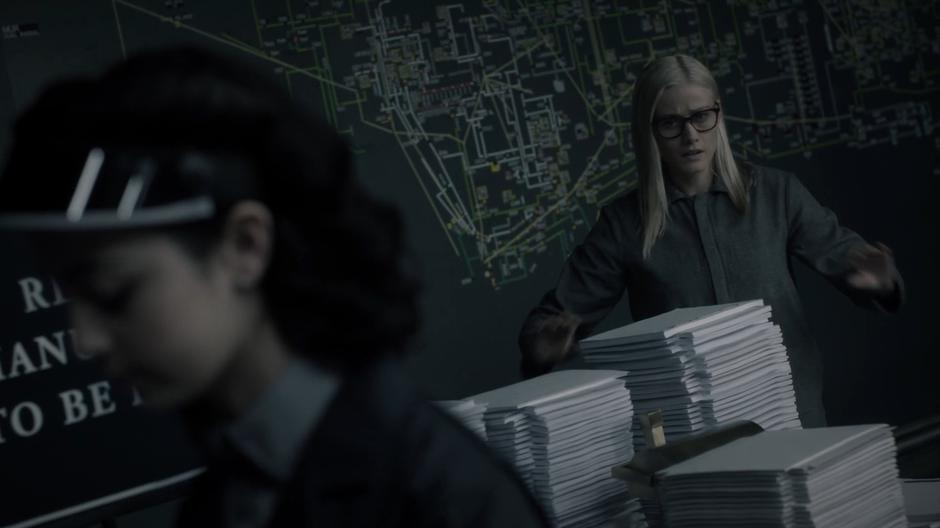 Alice appears in the revisions room and reaches for the manuscripts of her and her friends.