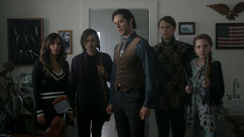 Margo, Quentin, Eliot, Charlton, and Fen look around the barbershop while Eliot explains this memory.