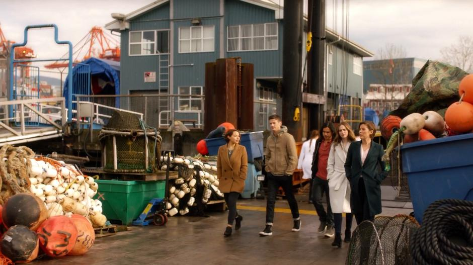 Nora, Barry, Cisco, and Caitlin follow Lyla down to the dock.