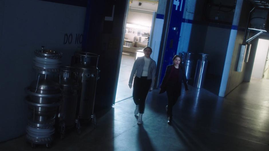Lia and Nora leave the lab after getting an unsatisfactory answer from the scientist.