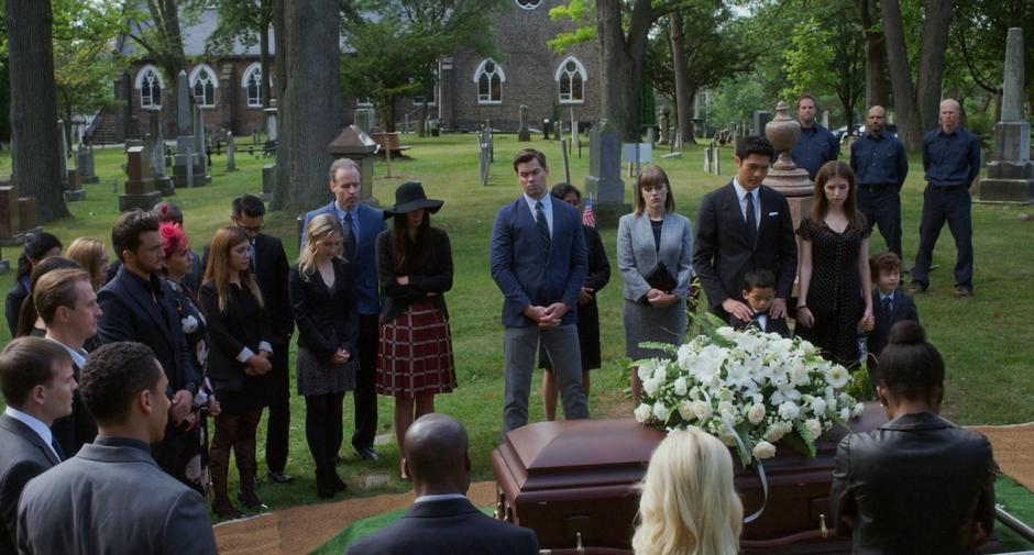 A group of mourners stand around Emily's coffin including Darren, Stacy, Sean, Nicky, Stephanie, and Miles.