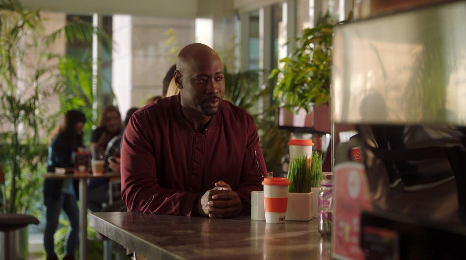 Amenadiel tells his order to the bemused barista.