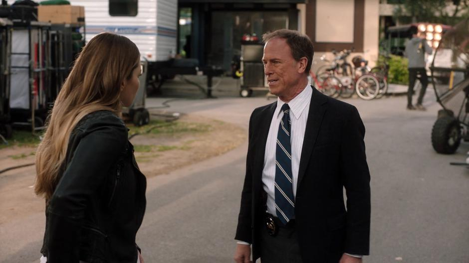 Chloe explains herself to her father outside her trailer.