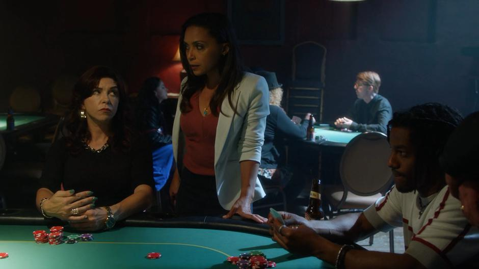 Debbie Dibny looks up at Cecile for her read on the other players at the table.