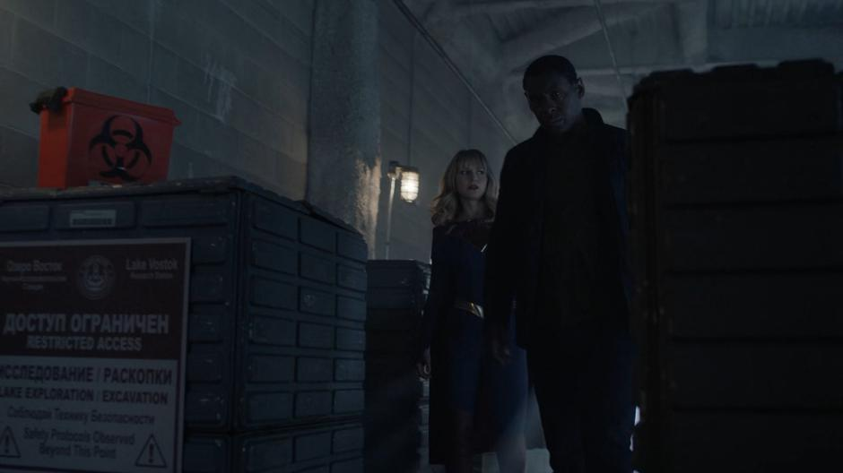Kara and J'onn search through the facility for any sign of Rip Roar.